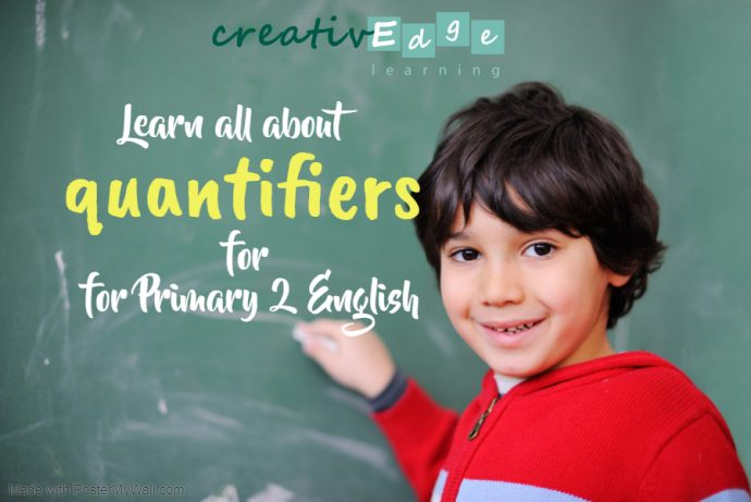 Boy writing on a blackboard - Learn all about quantifiers for Primary 2 English